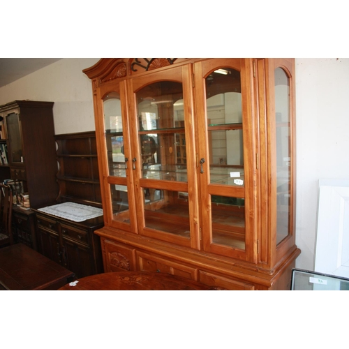 20 - Pine Back-Lit Display Cabinet having Glazed Three-Door Top Section over Two Cupboards flanking Three...