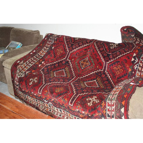 30 - Red Patterned Eastern Rug - approx 9' x 6'...