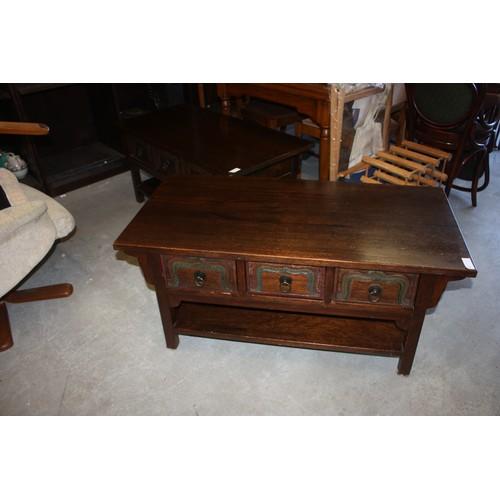 59 - A Dark Oak Coffee Table having three full length Under-drawers with Drop Handles with Undershelf 43