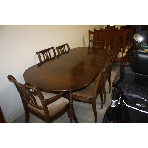 28 - Mahogany Inlaid Twin Pedestal Dining Table and Six Chairs (4 + 2 Carvers) with Upholstered Seats...
