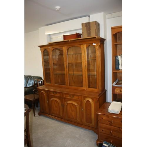 50 - Light Oak Glazed Dresser approx 6' Long by 7' High having Three Glazed Doors...