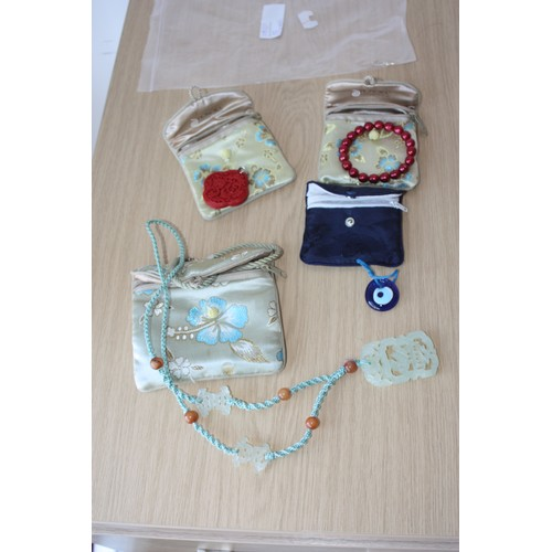 61 - Various Oriental Inspired Pendants including a Glass Lucky Eye, a Chinese Jade-Style Pendant on Silk...