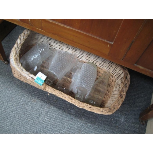 194 - Wicker Basket containing old Glass Milk Bottles...