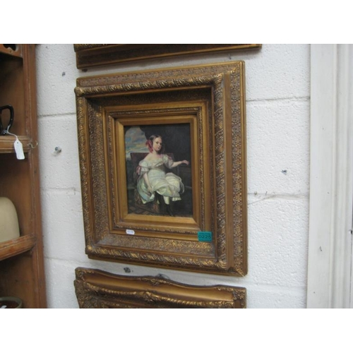 225 - Picture of a Young Girl in a heavy carved Frame...
