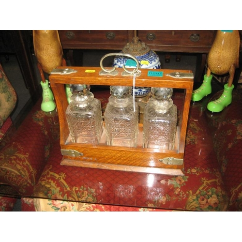 598 - Edwardian Oak Tantalus with 3 Cut Glass Decanters...