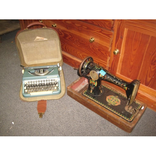 10 - Antique Singer Sewing Machine together with a Leather Cased Vintage Typewriter...