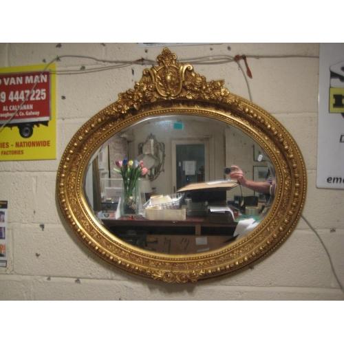 31 - Oval Gilt Framed Mirror with carved Frame...
