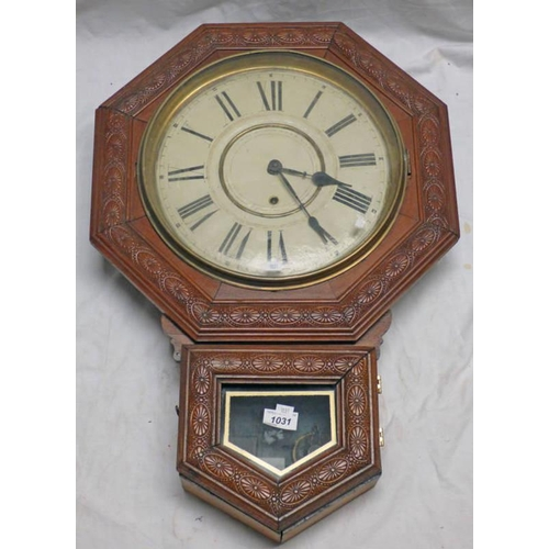 1031 - MAHOGANY CASED LATE 19TH CENTURY  WALL CLOCK WITH CARVED DECORATION. OVERALL LENGTH 67 CMS...