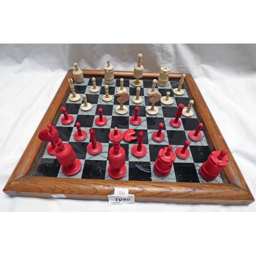 1040 - LATE 19TH CENTURY OAK FRAMED GLASS CHESS BOARD & VARIOUS 19TH CENTURY CHESS PIECES...