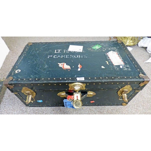 1051 - LUGGAGE TRUNK MARKED TO TOP OF LID  'LT HARDIE',  1ST CAMERONS' WITH A SELECTION OF VARIOUS LABELS T...
