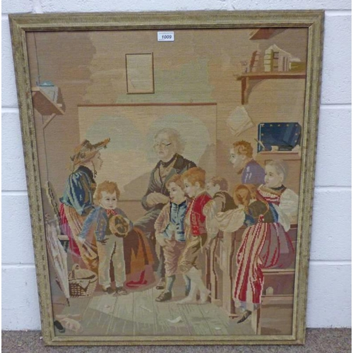 1009 - FRAMED SEWNWORK PICTURE OF A 19TH CENTURY FAMILY - 83 CM X 66 CM