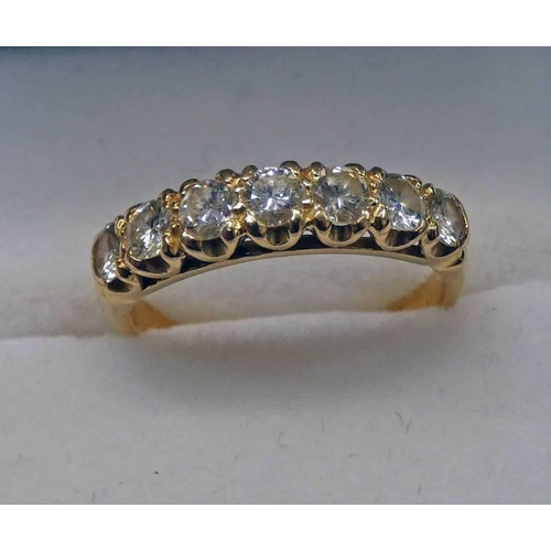 19 - GOLD 7 - STONE DIAMOND SET RING, THE CENTRE STONE APPROX 0.14 CARATS