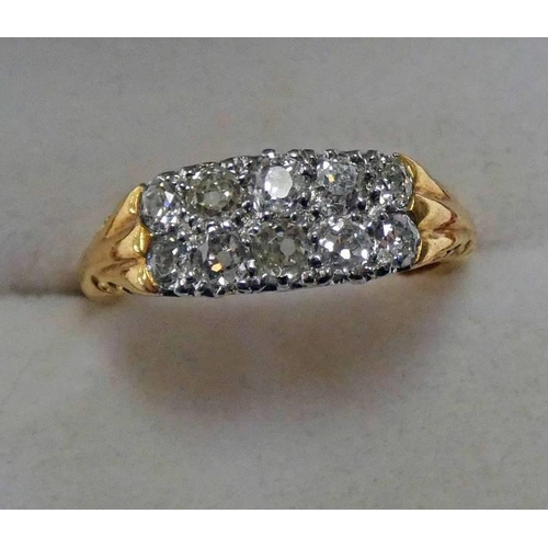 29 - DIAMOND SET 10-STONE RING, THE 2 ROWS OF 5 CUSHION SHAPED DIAMONDS IN A YELLOW METAL SCROLL MOUNT