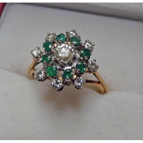 35 - EMERALD AND DIAMOND SET CLUSTER RING MARKED 18CT THE CENTRALLY SET DIAMOND OF APPROX. 0.25 CARAT