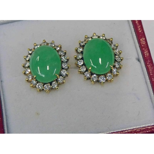 53 - PAIR OF JADE & DIAMOND CLUSTER EARRINGS, EACH OVAL CABOCHON JADE SET WITHIN A SURROUND OF 18 BRILLIA...