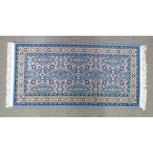 1027 - BLUE GROUND FLORAL DECORATED RUG 144 X 70 CM