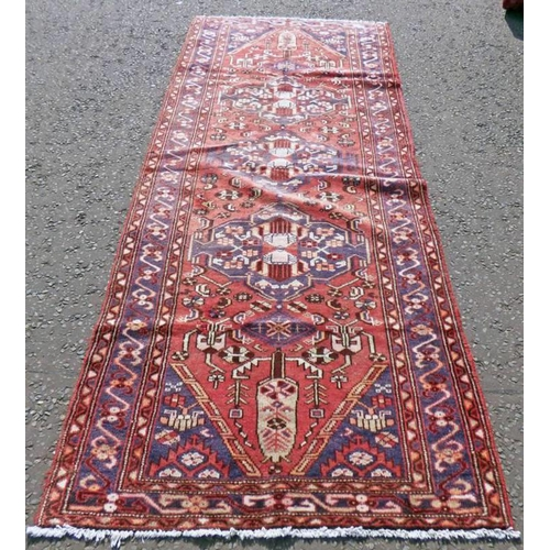 1038 - RED AND BLUE GROUND IRANIAN RUNNER WITH FLORAL MEDALLION DESIGN 296 X 115CM