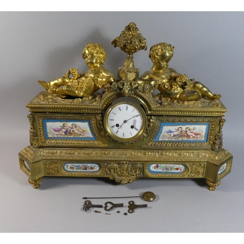 19 - A Large French Gilt Bronze Figural Mantle Clock with Sevres Style Panels Decorated with Cherubs and ...