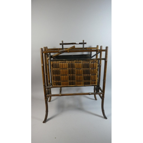 33 - A Bamboo Two Division Magazine Rack, 44cm Wide...