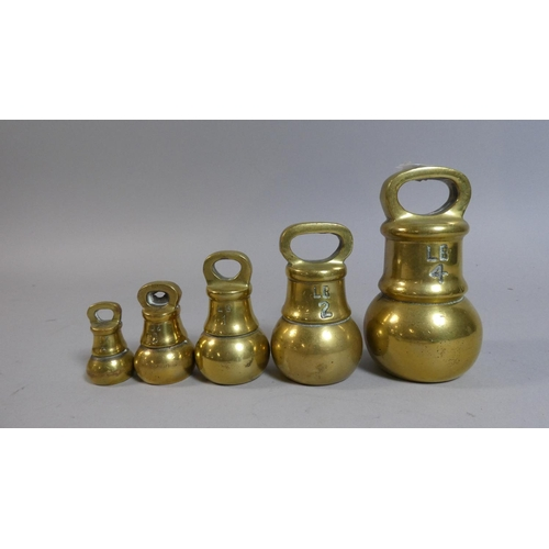 59 - A Set of Five Graduated Brass Bell Weights, the Tallest 12cm High...