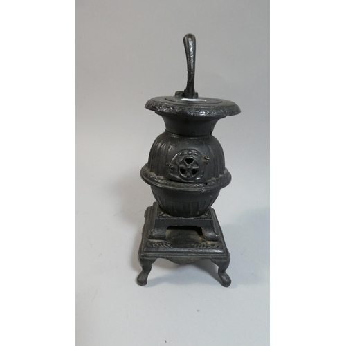 14 - A Cast Iron Model of a Pot Bellied Stove, 20cm High...