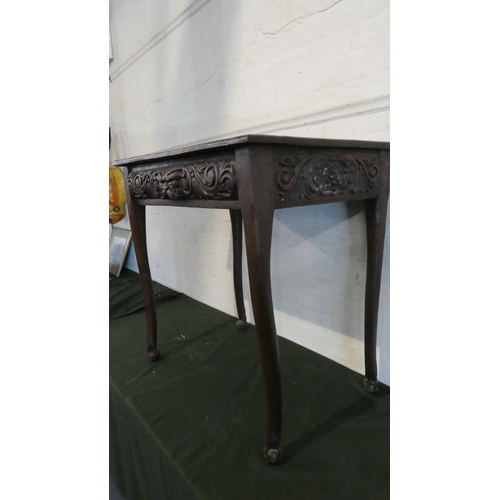 29 - A 19th Century Rectangular Oak Side Table with Carved Top Rails and Turned Supports Culminating in C...