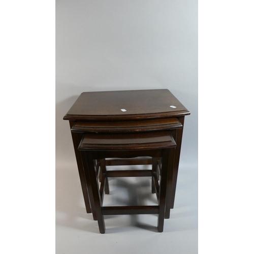 30 - An Edwardian Oak Nest of Three Tables...