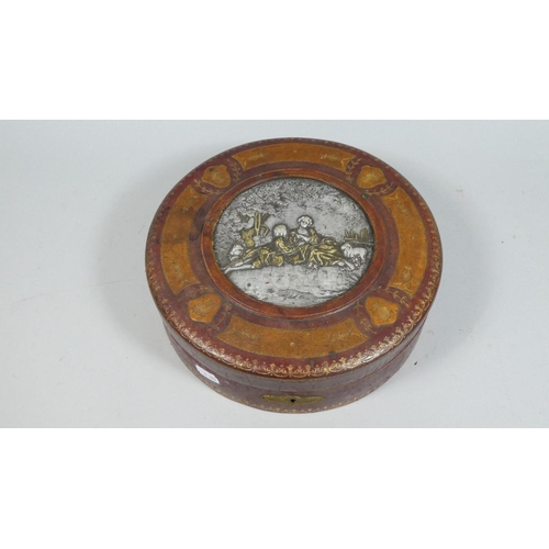 2 - A Leather Embossed Circular Box with Centre Silver Plated Cartouche Depicting Lovers In Garden, 25cm...