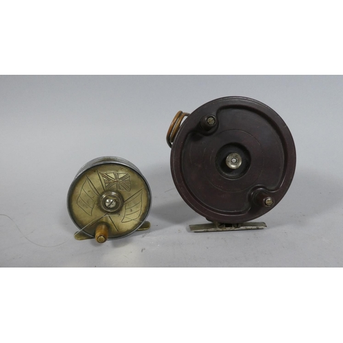 37 - A Vintage Brass Fishing Reel with Flag Decoration together with Larger Bakelite Example...