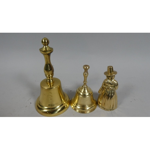 55 - Three Brass Desk Bells, one in the Form of Victorian Lady...