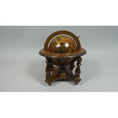 24 - A Reproduction Italian Miniature Table Globe, 20cm High...
