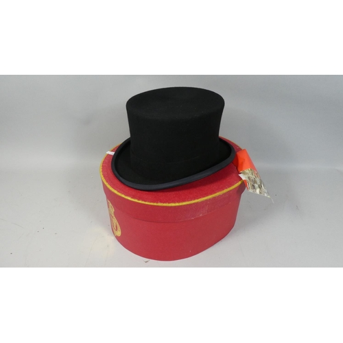 33 - A New and Unused Christie's Top Hat, Size 58cm and Complete with Box and Original Label Attached...