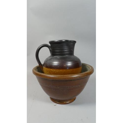 43 - A Treacle Glazed Stoneware Jug and Bowl...