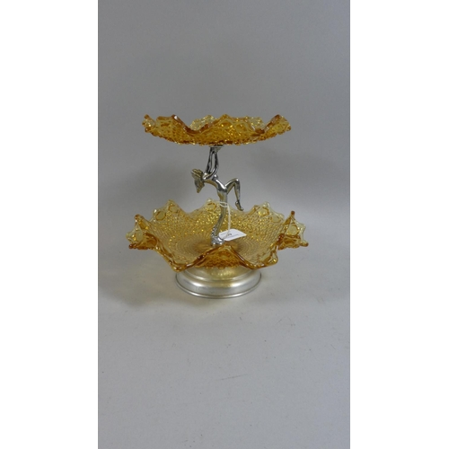 44 - A Mid 20th Century Chrome and Coloured Glass Two Tier Stand the Support in the Form of a Nude Maiden...