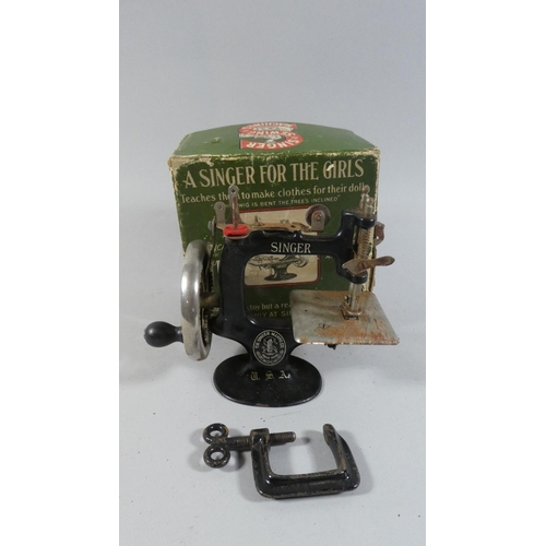 8 - A Vintage Boxed Singer Toy Sewing Machine,