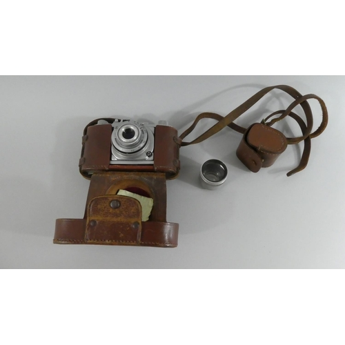11 - A Vintage Pigeon 35mm Camera, Together with Tele Hagon Hard Coated Additional Lens...