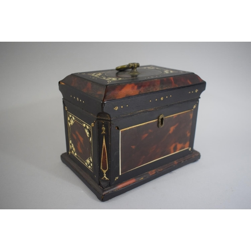 27 - A Mother of Pearl Inlaid Tortoiseshell Tea Caddy of Sarcophagus Form with Canted Sides. 18x12x14cms...