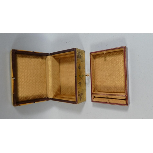 32 - A 19th Century Continental Tooled Leather Jewellery Box with a Fitted Interior. 18x14x8cms...