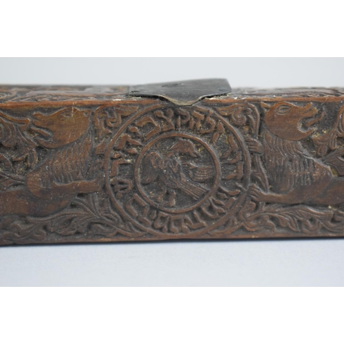 281 - An Early Hebrew Olive Wood Scribes Pen Box profusely Carved with Lions, Deer and Foliate Decoration....