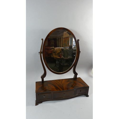 12 - A Mahogany Swing Toilet Mirror with Oval Glass and Serpentine Plinth Base, Having one Long and two S...