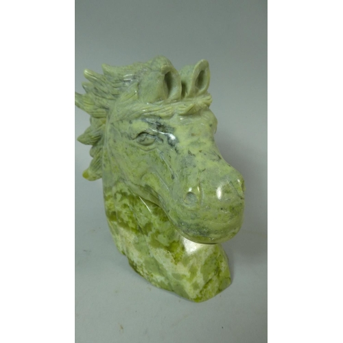 25 - A Carved Green Stone Study of a Horse's Head, 16cm High...