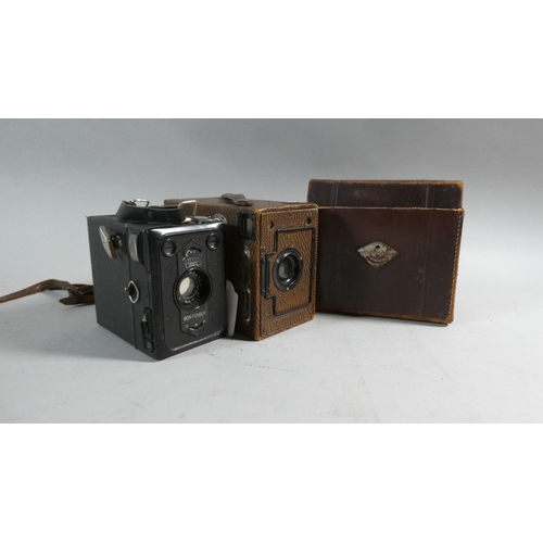 49 - A Vintage Leather Cased Zeiss Ikon Box-tengor Camera Together with an Ensign Rapid Rectilinear Model...