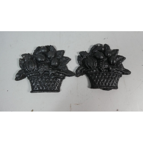 21 - A Pair of Cast Iron Wall Hangings in the Form of Baskets of Fruit, 11.5cm High...