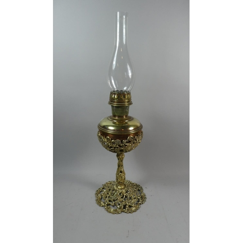 26 - A Late 19th Century Brass Oil Lamp with Pierced Support and Reservoir Holder, Complete with Glass Ch...