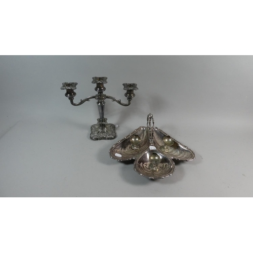 28 - A Collection of Silver Plate to Include Three Branch Candelabra, Three Shell Shaped Salts and a Tref...