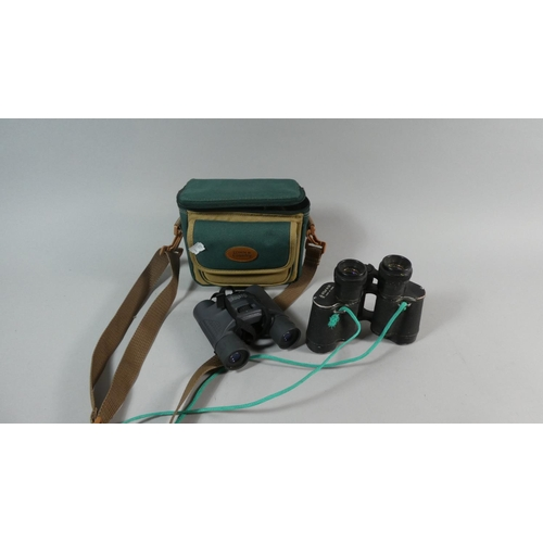 31 - Two Pairs of Binoculars One with Canvas Carrying Bag...