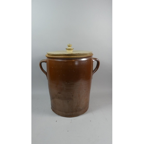 44 - A Glazed Stoneware Two Handled Milk Crock with Wooden Lid, 35cm High...