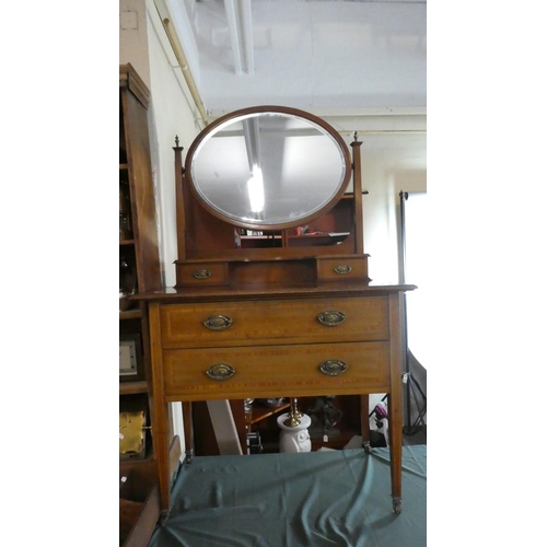 51 - An Edwardian Inlaid Mahogany Dressing Chest with Two Long Drawers, Raised Jewel Drawers and Oval Swi...