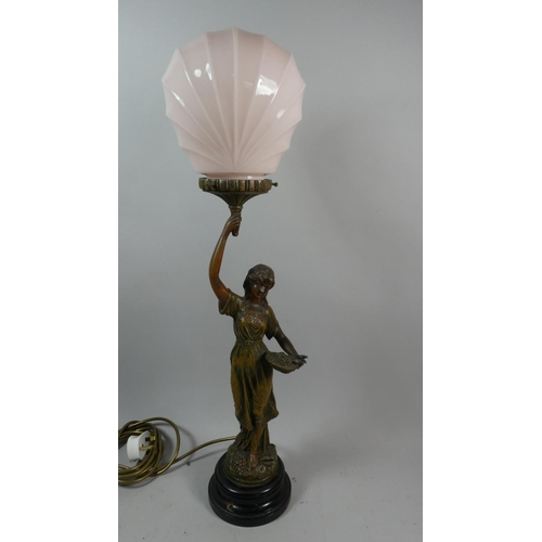 52 - A French Bronze Effect Figural Table Lamp with Opaque Glass Shade in the Form of Maiden with Basket ...