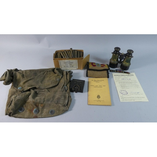 23 - A Tray Containing Various Items of Militaria to Include Spent Shells, Ruck Sack, Binoculars, Compass...